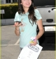 selena-gomez-phones-home-03.jpg